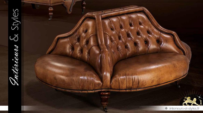 Canapé borne de forme ovale en cuir Havane capitonné