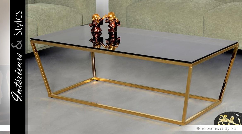 Table basse design dorée forme trapèze plateau verre fumé