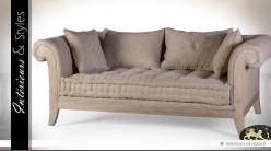 Canapé rétro bois massif habillage lin grège à motifs fleuris