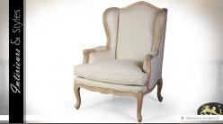 Bergère à oreilles de style Louis XV en bois massif et lin écru