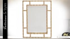 Miroir design à encadrement ajouré finition laiton doré ancien 90 cm
