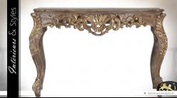 Console baroque en teck sculpté finition dorée vieillie 123 cm